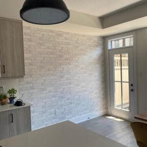 feature stone wall installation Toronto - OnBudget Painting